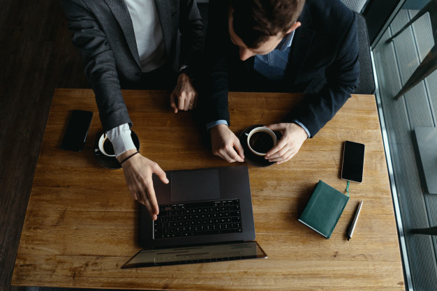 two businessmen pointing laptop screen while discussing 158595 5325 1